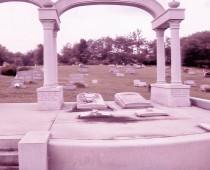 Do you know the notable person  who is not located in her grave? Helen Maries Vorhees Brach was presumably murdered on February 17, 1977 and her body was never found.  She has a tomb next to her husband Frank Vincent, in Unionport cemetery. However, the elaborate carved marble stone, in photo on left, covers an empty grave. She was an advocate for animals, founding a charity supporting animal anti-cruelty organizations. Buried under the marble arches are her parents, husband and two pet dogs, Candy and Sugar, but not her.